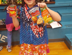 Student showing food collected at Madison