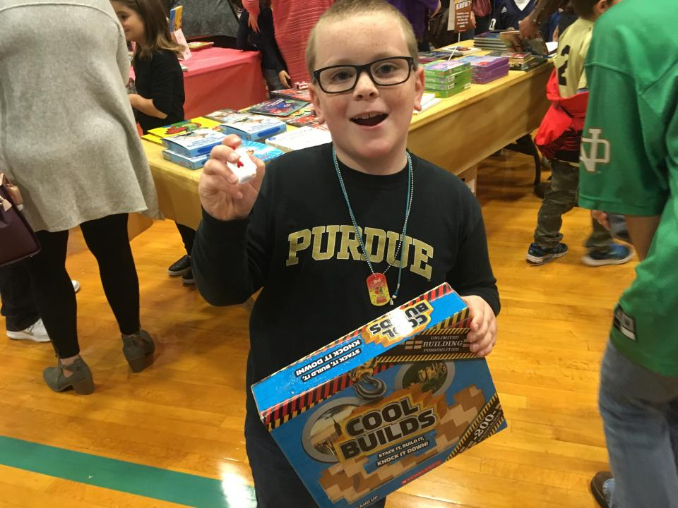 Small boy exclaims book fairs are great!