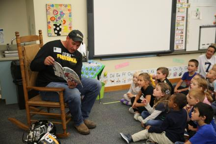 Penn graduate and former NFL player Bryan Mattison reads to his daughter's class