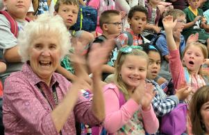 Teacher's Aide Anette Wisler & students happy to be back on the 1st Day of School