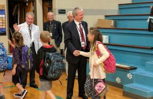 Board Members Larry Beehler, Jim Garrett and Supt. Dr. Thacker welcome students on the 1st Day of School